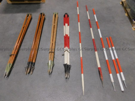 Picture of Lot of Tripods and Range Poles